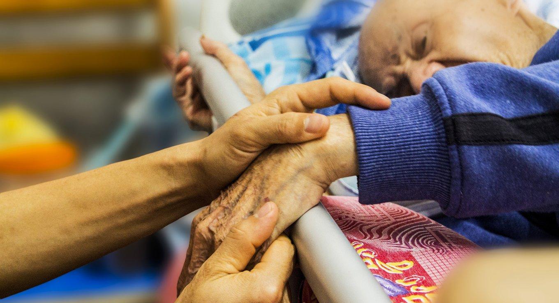 holding grandpa's hand