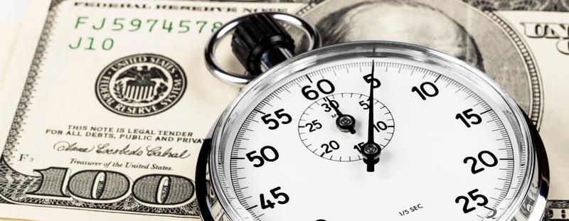 stopwatch on a $100 bill