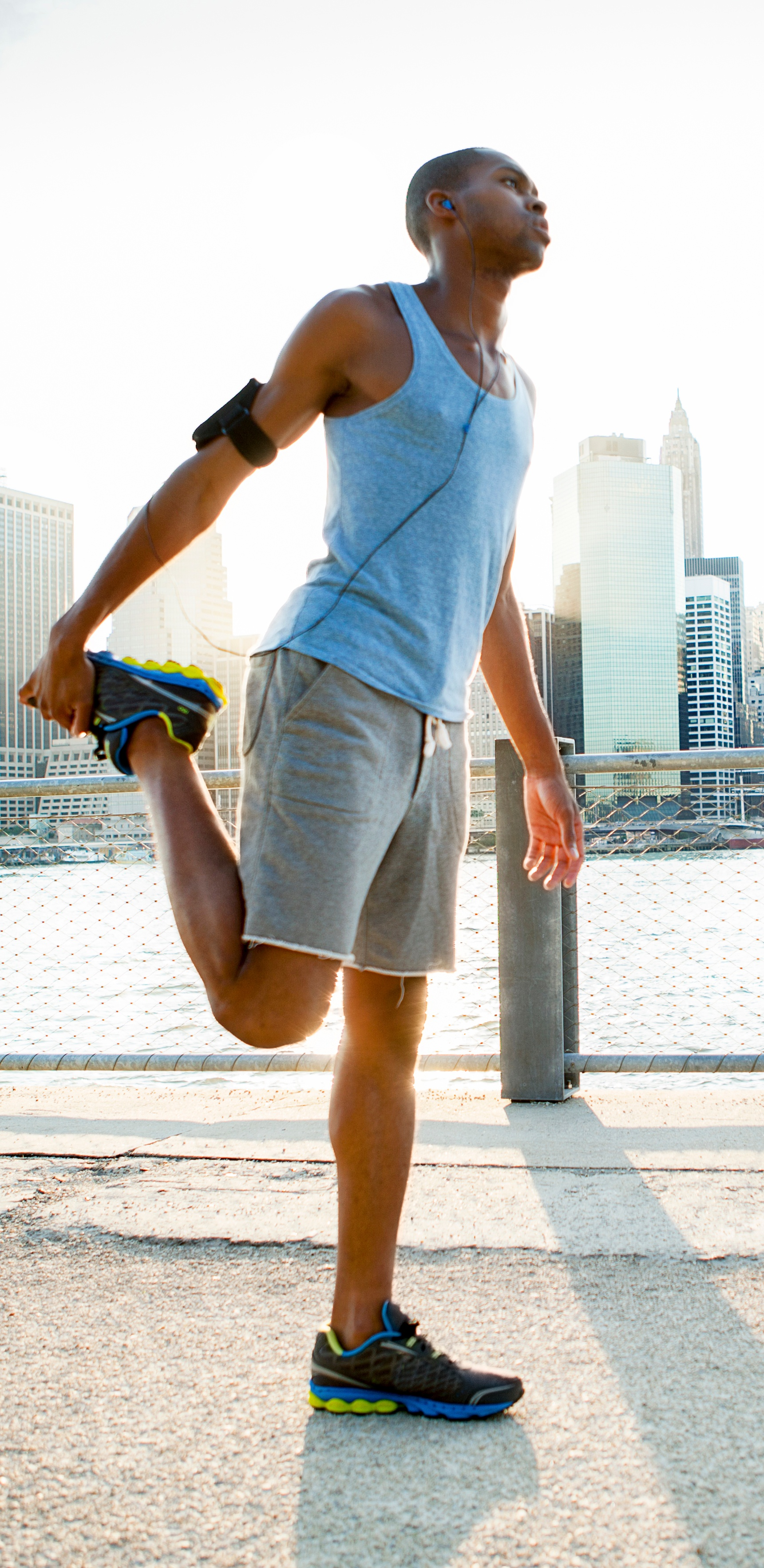 jogger stretching on pier